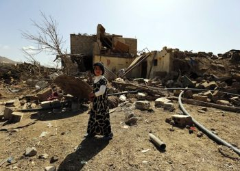 epa05179929 A child walks past her family's house that was destroyed by a Saudi-led airstrike at a neighborhood in Sana'a, Yemen, 25 February 2016. According to reports, the Saudi-led coalition stepped up its airstrikes on Sana'a, killing at least one man and wounding two children.  EPA/YAHYA ARHAB