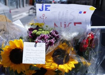 Flowers are pictured near the scene where a truck mowed through revelers in Nice, southern France, Friday, July 15, 2016.  A large truck mowed through revelers gathered for Bastille Day fireworks in Nice, killing more than 80 people and sending people fleeing into the sea as it bore down for more than a mile along the Riviera city's famed waterfront promenade.  (AP Photo/Francois Mori)