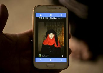 In this Wednesday, May 18, 2016 photo shows a phone image released by Islamic State militants of Nazdar Mahmoud, a 17-year-old Yazidi at Kankhe Camp for the internally displaced in Dahuk, northern Iraq. (AP Photo/Maya Alleruzzo)