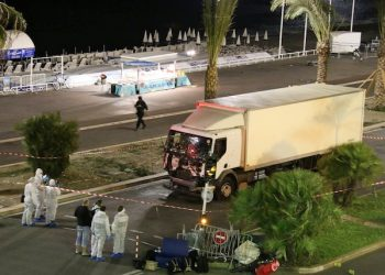 Authorities respond after a truck drove onto a sidewalk for more than a mile, plowing through Bastille Day revelers who'd gathered to watch fireworks in the French resort city of Nice, France, Thursday, July 14, 2016. Officials and eyewitnesses described as a deliberate attack. There appeared to be many casualties. (Sasha Goldsmith via AP)