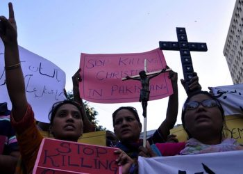 epa04482445 Pakistani members of the Christian minority hold banner as they shout slogans during a protest against the killing of a Christian couple who were burnt alive for alleged blasphemy, in Kot Radha Kishan, in Karachi, Pakistan, 09 November 2014. An angry mob on 05 November, burnt alive Shahzad Masih and his wife Shama Shahzad, a Christian couple in a village in Kot Radha Kishan for allegedly desecrating the Muslim holy book the Koran, police said, in another incident highlighting persecution of religious minorities. Police have arrested around 50 people after the provincial chief minister ordered an investigation into the incident, police said.  EPA/SHAHZAIB AKBER