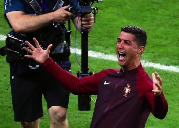 epa05419640 Cristiano Ronaldo of Portugal celebrates after the UEFA EURO 2016 Final match between Portugal and France at Stade de France in Saint-Denis, France, 10 July 2016. Portugal won 1-0 after extra time.  (RESTRICTIONS APPLY: For editorial news reporting purposes only. Not used for commercial or marketing purposes without prior written approval of UEFA. Images must appear as still images and must not emulate match action video footage. Photographs published in online publications (whether via the Internet or otherwise) shall have an interval of at least 20 seconds between the posting.)  EPA/SRDJAN SUKI   EDITORIAL USE ONLY