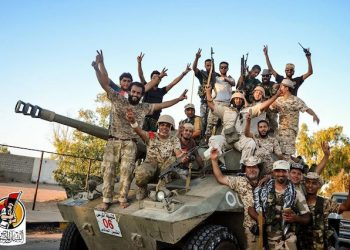 """U.S.-backed forces celebrate re-taking Sirte, Libya from the Islamic State group Thursday, Aug. 11, 2016. They have liberated """"70 percent"""" of the city of Sirte, the Islamic State group's last bastion in the North African country, after seizing several strategic locations over the past 24 hours under the cover of U.S. airstrikes, a Libyan official said Thursday. (Albinyan Al Marsous Operation Media Center via AP)"""