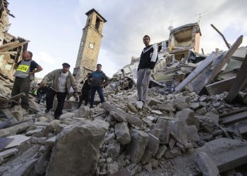 Rescuers on the rubble in Amatrice, central Italy, where a 6.1 earthquake struck just after 3:30 a.m., Italy, 24 August 2016. The quake was felt across a broad section of central Italy, including the capital Rome where people in homes in the historic center felt a long swaying followed by aftershocks. ANSA/ MASSIMO PERCOSSI