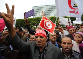 epa05004793 Tunisians shout slogans during a demonstration for the unemployed organized by the al-Mahaba Current, in Tunis, Tunisia, 31 October 2015. Hechmi Hamdi, chairman of al-Mahaba Current,  demands the government give a premium of 200 dinars for the unemployed and giving the government one month to implement the unemployment premium. In the absence of a favorable response from the authorities, a second event will be held next month to keep up pressure.  EPA/MOHAMED MESSARA