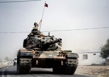 """Turkish army tanks and armoured personnel carriers move toward the Syrian border, in Karkamis, Turkey, Thursday, Aug. 25, 2016. Turkish President Recep Tayyip Erdogan late Wednesday said that Syrian opposition forces aided by Ankara have taken back the border town of Jarablus from the Islamic State group. Erdogan said the Syrian rebels, """"together with those who are from Jarablus, have now taken it back and IS has been forced to leave Jarablus.""""(AP Photo/Halit Onur Sandal)"""