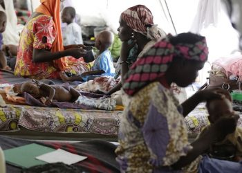 In this photo taken Monday Aug. 29, 2016. Women feeds their malnourished children at a feeding centre run by Doctors Without Borders in Maiduguri Nigeria. The whimpers from skeletally thin babies too weak to cry out are a harbinger of worse things to come: A quarter of the kids lucky enough to make it to this emergency feeding center are dying _ the latest victims of Boko Haram's Islamic insurgency.  (AP Photo/Sunday Alamba)