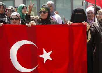 epa05427817 Supporters of Turkish President Recep Tayyip Erdogan wave Turkish flag during a demonstration in front  the Islamic Turkish hospital in Sidon, southern Lebanon, 16 July 2016. Lebanese members of Jamaa Islamiya (Muslim Brotherhood) gathered to protest against the attempted coup d'etat in Turkey. Turkish Prime Minister Yildirim reportedly said that the Turkish military was involved in an attempted coup d'etat. The Turkish military meanwhile stated it had taken over control.  EPA/STR