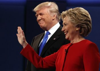 Republican presidential candidate Donald Trump, left, stands with Democratic presidential candidate Hillary Clinton at the first presidential debate at Hofstra University, Monday, Sept. 26, 2016, in Hempstead, N.Y. (ANSA/AP Photo/ Evan Vucci) [CopyrightNotice: Copyright 2016 The Associated Press. All rights reserved.]