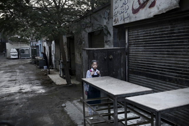 A girl makes her way to school in Giza, Egypt, Thursday, Nov. 17, 2016. Egypt is currently suffering an acute foreign currency shortage because of the decimation of its lucrative tourism industry, double digit rates of inflation and unemployment. (AP Photo/Nariman El-Mofty)