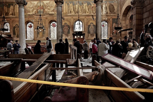 Security forces examine the scene inside the St. Mark Cathedral in central Cairo, following a bombing, Sunday, Dec. 11, 2016. The blast at Egypt's main Coptic Christian cathedral killed dozens of people and wounded many others on Sunday, according to Egyptian state television, making it one of the deadliest attacks carried out against the religious minority in recent memory. (ANSA/AP Photo/Nariman El-Mofty) [CopyrightNotice: Copyright 2016 The Associated Press. All rights reserved.]