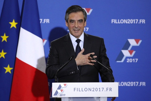 epa05650172 Former French Prime Minister and candidate for the right-wing primaries ahead of the 2017 presidential elections, Francois Fillon gestures toward the audience after making his speech following the second round, at Maison de la Chimie in Paris, France, 27 November 2016. Francois Fillon will fight the French presidential elections on 23 April and 07 May 2017, after first reports gives him the victory.  EPA/YOAN VALAT