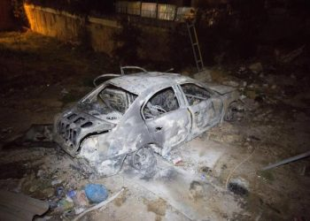 epa05740860 The wreckage of a car is seen at the site where a car bomb exploded, near Italian Embassy in Tripoli, Libya, 21 January 2017 (issued 22 January 2017). A security source said the car bomb killed two people who were inside.  EPA/STR