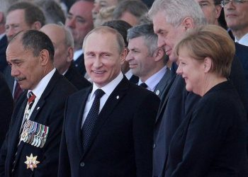 epa04242605 (L-R) Governor-General of New Zealand Jerry Mateparae, Russian President Vladamir Putin, Czech President Milos Zeman, German Chancellor Angela Merkel, and world leaders at Sword Beach during a service of remembrance in Ouistreham, Normandy, France, 06 June, 2014. World leaders are gathering in Normandy 06 June to commemorate the 70th anniversary of the D-Day landings. More than 75,000 British Canadian and other Commonwealth Troops landed on the beaches of Normandy on 06 June 1944 alongside the United States and the Free French, in an Allied invasion of more than 130,000. Another 7,900 British troops were landed by Air.The invasion established a crucial second front in the Liberation of Europe from Nazi occupation, ultimately leading to victory for Allied Forces in 1945.  EPA/ANDY RAIN  EPA/ANDY RAIN