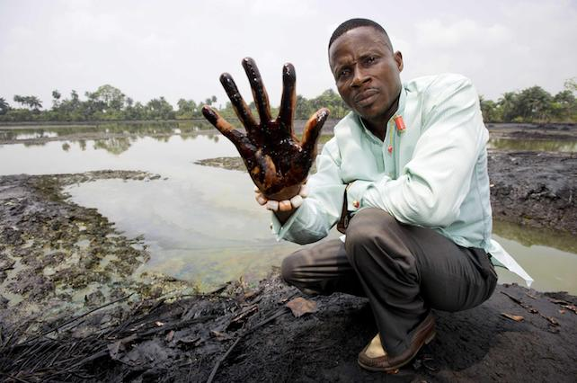 epa03556207 A undated image showing plaintiff Nigerian farmer Eric Dooh showing his hand covered with oil from a creek near Goi, Ogoniland, Nigeria. According to a report of UNEP (United Nations Environment Programme), leaks in Shell pipelines in Nigeria occur regularly, causing harm to communities in the Niger Delta region. A group of Nigerian plaintiffs claim Shell is liable for the damage the leaks caused, while Shell claims most leaks are the result of sabotage. Reports also state fishponds and farmland have been destroyed, while most locals have no other option but to drink from polluted water. Eric Dooh from Goi (Ogoniland), Alali Efanga from Oruma (Bayelsa) and Friday Alfred Akpan from Ikot Ada Udo (Akwa Ibom), individual farmers from three different communities in the Niger Delta, have taken Shell into the Dutch civil court of The Hague in a landmark pollution case, asking for compensation for damages to their land. The verdict in the case is due 30 January 2013.  EPA/MARTEN VAN DIJL