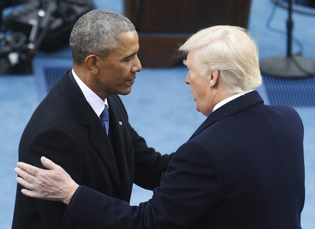 epa05735371 President-elect Donald J. Trump (R) is greeted by President Barack Obama as arrives to be sworn in as the 45th President of the United States in Washington, DC, USA, 20 January 2017. Trump won the 08 November 2016 election to become the next US President.  EPA/JIM LO SCALZO