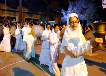 epa05135644 A member of the Zoroastrian priesthood leads a procession as she carries the Zoroastrian holy fire during a ceremony called 'Sade' which is held 50 days before the Iranian New Year, at the Markar Garden, east of the capital Tehran, Iran, 30 January 2016. Sade is a mid winter festival that was celebrated with grandeur and magnificence in ancient Iran which honors the fire's power to defeat the forces of darkness and frost. Zoroastrianism is said to be one of the world's oldest religions which was founded by the Prophet Zoroaster (or Zarathustra) in ancient Persia about 3,500 years ago.  EPA/ABEDIN TAHERKENAREH