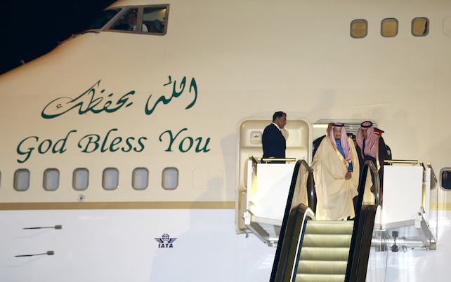 Saudi Arabia's King Salman step down the ramp upon his arrival at Haneda International Airport in Tokyo, Sunday, March 12, 2017. (AP Photo/Shizuo Kambayashi)