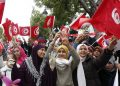 epa05716772 Tunisian women wave national flags during the celebration to mark the sixth anniversary of the uprising that ousted president Zine El Abidine Ben Ali, at the Avenue Habib Bourguiba in Tunis, Tunisia, 14 January 2017. Ben Ali and his wife went into exile in Saudi Arabia on 14 January 2011.  EPA/MOHAMED MESSARA
