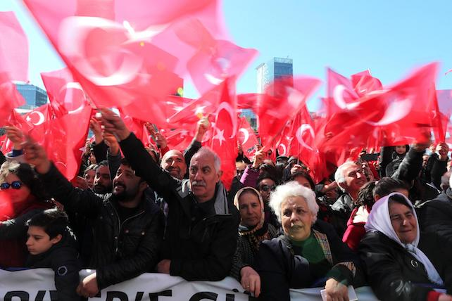 epa05882783 Supporters of the Republican People's Party (CHP) hold Turkish flags and shout slogans for 'Vote No' referring to upcoming referendum during a rally for opening ceremony of Sariyer District Municipality building, in Istanbul, Turkey, 01 April 2017. A referendum on the constitutional reform is expected to be held in April. The reform, passed by Turkish parliament on 21 January, would change the country's parliamentarian system of governance into a presidential one, which the opposition denounced as giving more power to Turkish president Recep Tayyip Erdogan..  EPA/TOLGA BOZOGLU