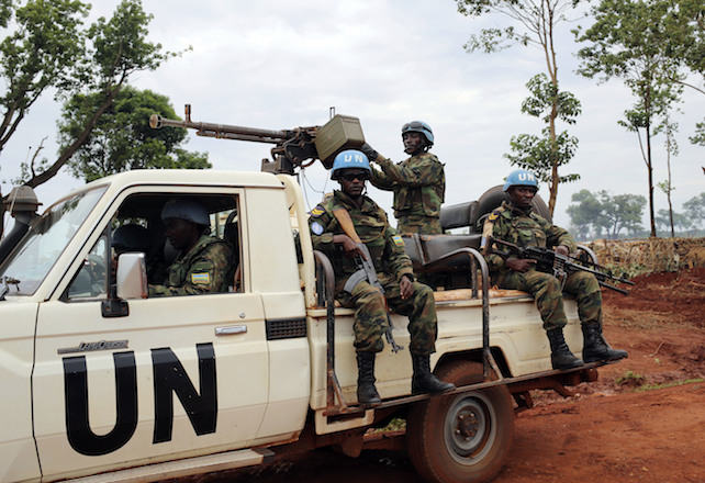 "This photo taken Friday May 26, 2017, shows  UN peacekeepers patrolling outside Bria, Central African republic. The U.N. humanitarian agency said the unprecedented violence emptied Bria of its population, sending an ""uninterrupted stream"" of residents toward makeshift camps.The largest has been set up near the local U.N. base, swelling to over 25,000 people in just two days. (AP Photo/Cassandra Vinograd)"