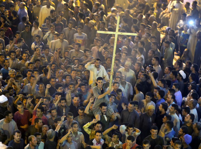 Coptic Christians shout slogans after funeral service at Abu Garnous Cathedral in Minya, Egypt, Friday, May 26, 2017. Egyptian officials say dozens of people were killed and wounded in an attack by masked militants on a bus carrying Coptic Christians, including children, south of Cairo.(AP Photo/Amr Nabil)