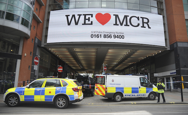 Police evacuate Arundel shopping centre near to the Manchester Arena in central Manchester, England Tuesday May 23 2017. Police confirmed that 19 people were killed in an explosion following a Ariana Grande concert at the venue late Monday evening.  (AP Photo/Rui Vieira)