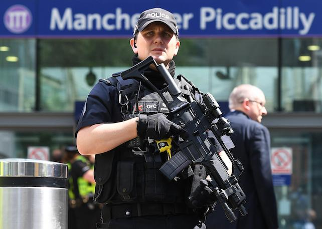 epa05983562 Armed police on patrol in central Manchester, Britain, 23 May 2017. According to a statement by the Greater Manchester Police, at least 22 people have been confirmed dead and around 59 others were injured, in an explosion at the Manchester Arena on the night of 22 May at the end of a concert by US singer Ariana Grande. Police believe that the explosion, which is being treated as a terrorist incident, was carried out by a single man using an improvised explosive device (IED), who was confirmed dead at the scene. British Prime Minister Theresa May in the meantime had condemned the incident as 'an appalling terrorist attack.'  EPA/ANDY RAIN