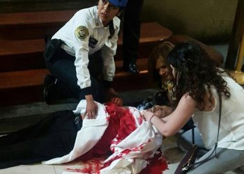 epa05967044 Two woman and a police officer try to help a priest that was stabbed during mass at the Catedral Metropolitana in Mexico City, Mexico, 15 May 2017. The priest is currently hostitalized in 'delicate but stable' condition, according to goverment and Ecclesiastical sources. Official sources stated that the Federal Police 'handed over to the Centra Investigation Agency a man of approximately 28 years of age, who allegedly stabbed the priest'. The alleged assailant 'called himself John Rock Schild' and is apparently a north american artist.  EPA/STR ATTENTION EDITORS: GRAPHIC CONTENT