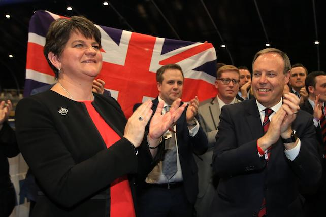 epa06017996 Democratic Unionist Party (DUP) leader Arlene Foster celebrates with her north Belfast candidate Nigel Dodds (R) after winning his Westminster seat at the Belfast count center in Belfast, Northern Ireland, Britain, 09 June 2017. DUP took north, east and south Belfast with Sinn Fein keeping west Belfast. British voters went to the polls on 08 June, to cast their ballot to elect a total of 650 Westminster Members of Parliament to form the next British Government, in a General Election called by British Prime Minister Theresa May.  EPA/PAUL MCERLANE