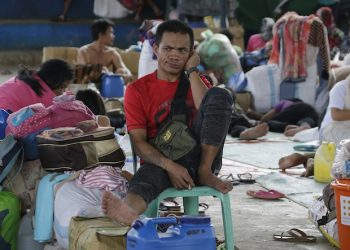 In this June 9 photo, An evacuee waits inside an evacuation center on the ouskirts of Marawi city, southern Philippines Friday, June 9, 2017. Nearly every day for the past three weeks, the Philippine military has pounded the lakeside town of Marawi with rockets and bombs as it tries to wipe out militants linked to the Islamic State group in some of the most protracted urban combat to hit this volatile region in decades. (AP Photo/Aaron Favila)
