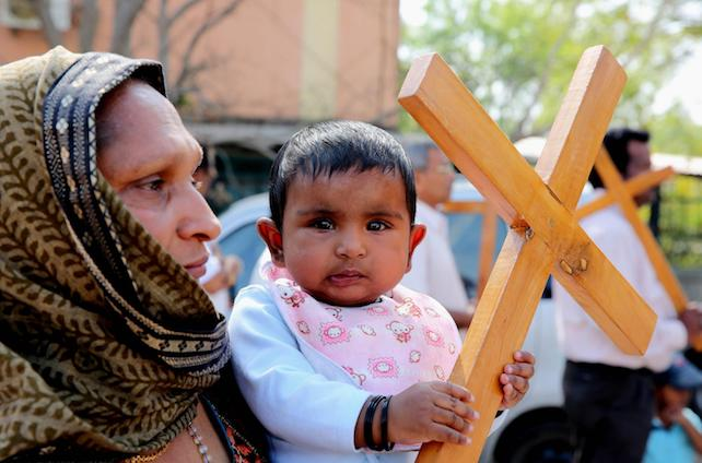 epa05906988 Christian devotees carry crosses while participating in a religious procession on the occasion of Good Friday in Bhopal, India, 14 April 2017. It is the one of the highest religious holidays observed by Christians all over the world, commemorating the crucifixion of Jesus Christ and his death at Golgotha, a central event in Christian theology.  EPA/SANJEEV GUPTA