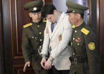 American student Otto Warmbier, center, is escorted at the Supreme Court in Pyongyang, North Korea, Wednesday, March 16, 2016. North Korea's highest court sentenced Warmbier, a 21-year-old University of Virginia undergraduate student, from Wyoming, Ohio, to 15 years in prison with hard labor on Wednesday for subversion. He allegedly attempted to steal a propaganda banner from a restricted area of his hotel at the request of an acquaintance who wanted to hang it in her church. (ANSA/AP Photo/Jon Chol Jin)