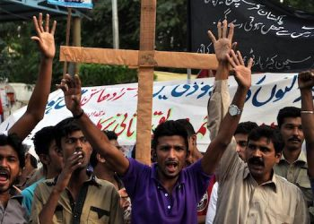 epa04482446 Pakistani members of the Christian minority shout slogans during a protest against the killing of a Christian couple who were burnt alive for alleged blasphemy, in Kot Radha Kishan, in Karachi, Pakistan, 09 November 2014. An angry mob on 05 November, burnt alive Shahzad Masih and his wife Shama Shahzad, a Christian couple in a village in Kot Radha Kishan for allegedly desecrating the Muslim holy book the Koran, police said, in another incident highlighting persecution of religious minorities. Police have arrested around 50 people after the provincial chief minister ordered an investigation into the incident, police said.  EPA/SHAHZAIB AKBER