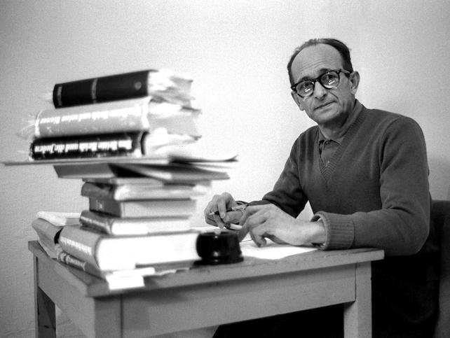 JER02 - 19610415 - RAMLE, ISRAEL : (FILES) A file picture taken 15 April 1961 shows Nazi war criminal Adolf Eichmann sitting at a desk in his cell at the Ramle prison in Israel. Israel prepared 13 August 1999 to lift the lid on Eichmann's memoirs after keeping the document hidden from public view for nearly 40 years. Eichmann was kidnapped by Israeli agents in Argentina and executed in 1962 in Jerusalem.  EPA PHOTO/AFP/GPO FILES/-/jd/ja