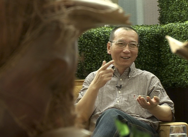 In this image taken from June 3, 2008,  video footage by AP Video, Liu Xiaobo speaks during an interview before his detention in Beijing, China. China's ailing Nobel Peace Prize laureate Liu Xiaobo's health is further deteriorating as abdominal fluid accumulates, said a friend on Thursday, July 6, 2017, and the Chinese hospital that is treating him, adding to concerns about the long-term prognosis of the country's best-known political prisoner.(AP Video via AP)
