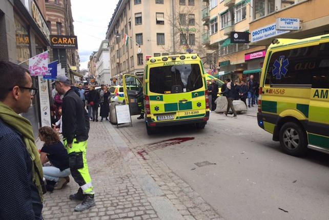 epa05894716 Emergency services help the injured near the scene where a truck reportedly crashed into a department store in central Stockholm, Sweden, 07 April 2017. A truck has driven into a department store on Drottninggatan street (Queen Street) in central Stockholm, media reported quoting local police. According to initial reports, at least three people were killed and others were injured in the incident, media added. Swedish Prime Minister Stefan Loefven commented that everything indicated the incident as a 'terror attack.'  EPA/ROSE-MARIE OTTER -- BEST QUALITY AVAILABLE -- SWEDEN OUT