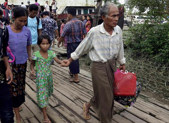 epa06164294 Displaced Rakhine ethnic people from Maungdaw township arrive to the Sittwe port, Sittwe, Rakhine State, western Myanmar, 26 August 2017. According to a statement by the Myanmar Armed Forces, at least 32 people, including 11 law enforcement officials, were killed on 25 August in Myanmar after Rohingya militants attacked police outposts and an army base in the western state of Rakhine.  EPA/NYUNT WIN