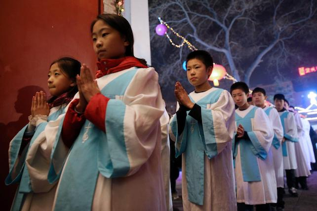 epa05687548 Members of a choir attend the Christmas Eve mass in the state-approved Xuanwumen Catholic Church, otherwise known as the South Cathedral in Beijing, China 24 December 2016. Christians in China attend church masses as they prepare to celebrate the religious holiday to commemorate the birth of Christ.  EPA/WU HONG