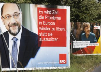 """Election campaign posters of German Chancellor Angela Merkel, right, reading: """"Clever, Cool-headed, Resolute  That Our Country Remains On The Course Of Success"""". and her challenger Martin Schulz of the Social Democrats, left, reading: """" It Is Time To Solve Europe's Problems Instead Sitting On The Sidelines. """"  are displayed in  a street in Berlin, Tuesday, Sept. 5, 2017. General election for a new parliament will take place in Germany on Sunday, Sept. 24, 2017. (AP Photo/Markus Schreiber)"""