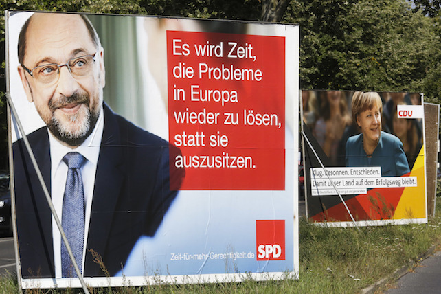 "Election campaign posters of German Chancellor Angela Merkel, right, reading: ""Clever, Cool-headed, Resolute  That Our Country Remains On The Course Of Success"". and her challenger Martin Schulz of the Social Democrats, left, reading: "" It Is Time To Solve Europe's Problems Instead Sitting On The Sidelines. ""  are displayed in  a street in Berlin, Tuesday, Sept. 5, 2017. General election for a new parliament will take place in Germany on Sunday, Sept. 24, 2017. (AP Photo/Markus Schreiber)"