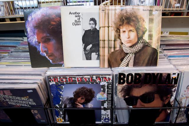epa05583832 The records 'At Budokan' (top, L-R), 'Another side of Bob Dylan', 'Blonde on Blonde, 'Emprie Burlesque' (bottom-C) and 'Infields' (bottom-R) by US singer-songwriter Bob Dylan lie in a record store in Munich, Germany, 13 October 2016. Dylan won the 2016 Nobel Prize in Literature, the Swedish Academy announced in Stockholm on 13 October 2016.  EPA/SVEN HOPPE ILLUSTRATION
