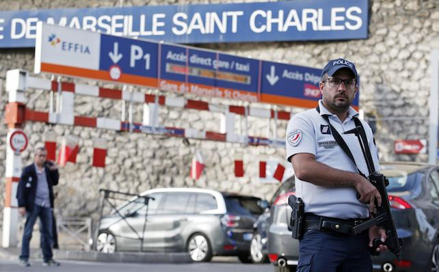 epa06238818 Police offciers guard at the train station of Saint Charles after a man armed with a knife had allegedly attacked passengers at the train station, in Marseille, France, 01 October 2017. According to media reports, at least two people were killed by a man with a knife at Gare de Marseille-Sain Charles.  EPA/Sebastien Nogier