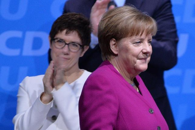 epa06566312 German Chancellor Angela Merkel (R) is applauded by designated Secretary General Annegret Kramp Karrenbauer (L front) and others after delivering her speech at the 30th convention of the Christian Democratic Union (CDU) party in Berlin, Germany, 26 February 2018. The party delegates are scheduled to vote on the start of the CDU into a government coalition with the Social Democratic Party (SPD) and the Christian Social Union (CSU). On the previous day, the CDU party leader and German Chancellor Angela Merkel presented her list of candidates for the CDU cabinet members.  EPA/PHILIPP GUELLAND
