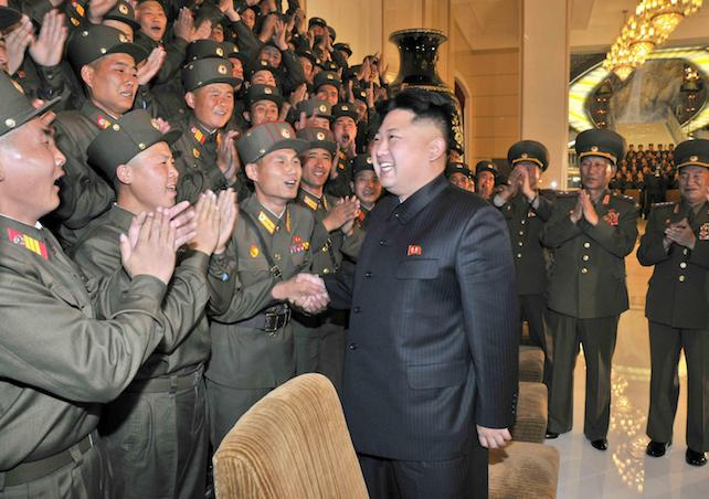"""epa04083331 An undated picture released by the North Korean Central News Agency (KCNA) on 29 October 2013 shows North Korean leader Kim Jong-un as he is welcomed by a group of soldiers who have been picked to participate in the 38th military art festival, in Pyongyang, North Korea. Crimes against humanity are being committed in North Korea under the personal control of Kim Jong Un, UN rights investigators said 17 February 2014 in Geneva, calling for the International Criminal Court in The Hague to take action. The UN Human Rights Council initiated the investigation last year after efforts to engage Pyongyang on human rights issues proved fruitless. The three members of the Commission, led by former Australian judge Michael Kirby, were not allowed into North Korea. They held hearings with defectors and former inmates of North Korea's prison system, and collected expert reports. Satellite images were used to confirm prison camps, the existence of which is denied by the Communist regime. The commission said that the crimes against humanity that were committed include killings, torture, rape, forced abortion, political prosecution and starvation. In a separate letter to Kim, Commission chairman Michael Kirby said that officials have been committing such crimes """"under the effective control"""" of Kim, who is supreme leader, as well as military and Communist party chief.  EPA/KCNA SOUTH KOREA OUT,  NO SALES"""