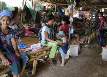 epa06727728 Internally displaced Kachin ethnic people sit inside a temporary refugee camp at Tan Phae village Roman Catholic church in Myitkyina, Kachin State, northern Myanmar, 11 May 2018. Thousands of Kachin ethnic people fled from the renewed fighting between Myanmar Army and Kachin Independence Army (KIA).  EPA/SENG MAI