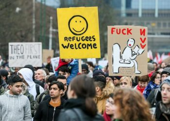 epa06435965 People gather and hold banners reading 'Refugees Welcome' to protest against the migration policy of the Belgian Secretary of State for Immigration, Theo Franken in Brussels, Belgium, 13 January 2018. According to reports, civil society and human rights representatives are calling for the resignation of Theo Francken claiming he failed to respect his mandate and violated the constitution and laws by sending migrants back to their countries to torture, and inhuman and degrading treatment.  EPA/STEPHANIE LECOCQ