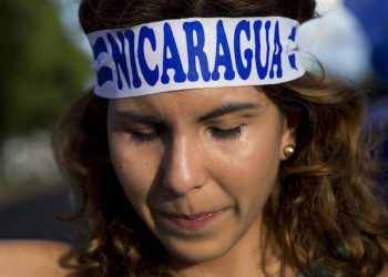 epa06820008 A young woman cries during a sit-in at an event held to commemorate the start of the anti-government protests in Nicaragua, which have been sustained for two months, and have resulted in the deaths of at least 180 people, in Managua, Nicaragua, 18 June 2018. Dozens of people returned to peacefully protest in the same place where two months ago a sit-in was held to reject reforms to Social Security in Nicaragua, and became the catalyst for the anti-government protests and political violence in the Central American country.  EPA/JORGE TORRES