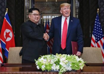 epa06801604 US President Donald J. Trump (R) and North Korean Chairmain Kim Jong-un (L) shake hands after signing a document during their historic DPRK-US summit, at the Capella Hotel on Sentosa Island, Singapore, 12 June 2018. The summit marks the first meeting between an incumbent US President and a North Korean leader.  EPA/KEVIN LIM / THE STRAITS TIMES /   EDITORIAL USE ONLY  EDITORIAL USE ONLY