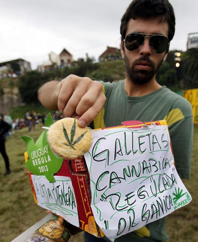 epa04190487 A man sells marijuana cookies at Molino de Perez park after participating in the First World March of Regulated Marijuana, in Montevideo, Uruguay, 03 May 2014. Uruguay legalized the buying and selling and the cultivation of marijuana in the country.  EPA/Ivan Franco